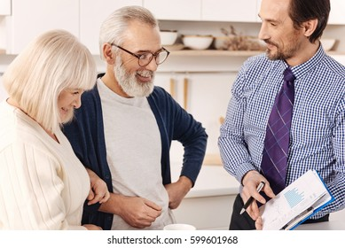 Friendly realtor presenting the contract for apartment investment to clients