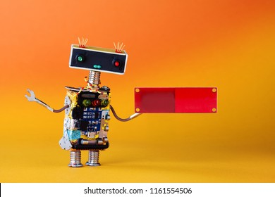 Friendly robot with blank red circuit board for text. Orange yellow background, copy space.