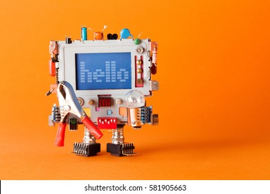 Friendly robot with funny monitor head. Colorful retro display character message hello on blue screen. Communication television concept. orange background copy space.