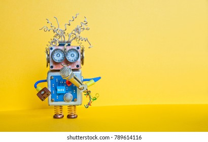Friendly robot with microphone, singing song. Music lecture performance poster design. Smiley face cyborg toy, yellow background, copy space.