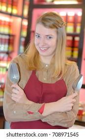 friendly smiling female bakery teacoffee shop worker