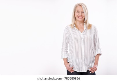 Friendly smiling middle-aged woman isolated on white background. Happy pretty women
