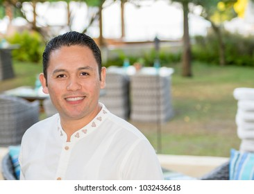 Friendly, Smiling, Young Mexican Man Working as a Server at a Resort Restaurant in Mexico