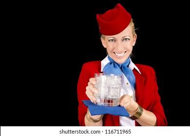Friendly Stewardess Bringing a Welcoming Beverage.