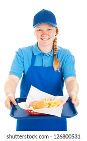 Friendly teenage fast food worker serving a burger and fries meal with a smile.  Isolated on white.
