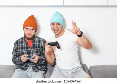 Friendly video game competiton. Winner and looser. Happy and sad men are holding joysticks. cybersport challenge