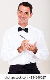 friendly waiter taking order from customer