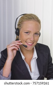 friendly woman with headset in customer service