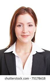Friendly young business woman smiling into the camera