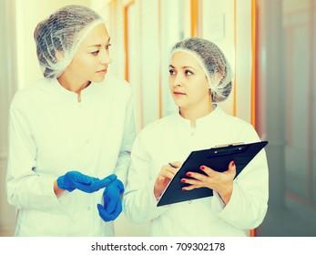 Friendly young doctors describing beauty procedures in aesthetic medicine center