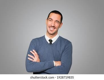 Friendly young man winking an eye