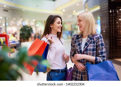 Friends after shopping in the store