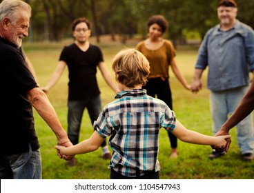 Friends of all ages holding hands