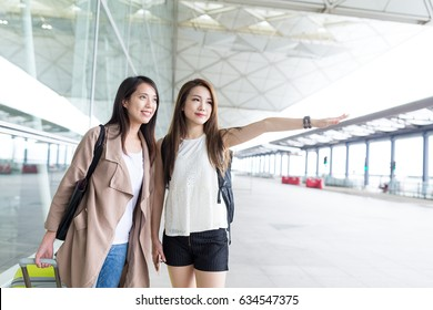 Friends asking for taxi in Hong Kong airport
