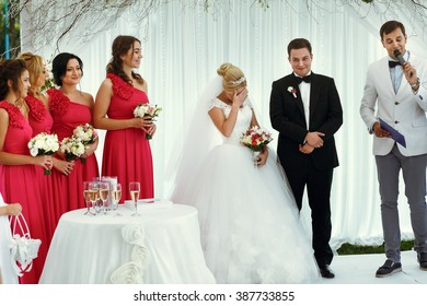 Friends of bride and groom with newlyweds on the wedding ceremony