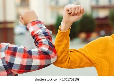 Friends bump elbows outdoors. Coronavirus epidemic. Health care concept. Social distancing. Elbow bump. New greeting style. Coronavirus quarantine. Fight coronavirus.