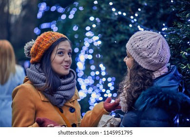 Friends Buying Candies On Christmas Market