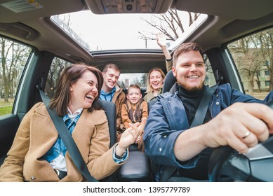 friends in car with little kid. car travel concept. adventure time
