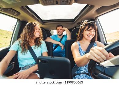 friends in car. road trip. view from inside, wide angel