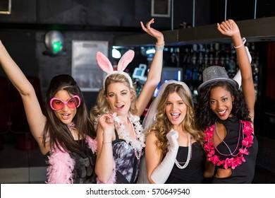 Friends celebrating bachelorette party in a nightclub
