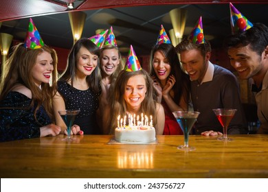 Friends celebrating a birthday together at the nightclub
