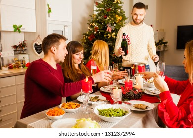 Friends celebrating Christmas or New Year eve at home
