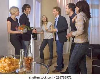 Friends celebrating with food and drinks.