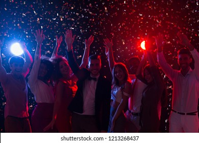 Friends celebrating New Year at night club, dancing and having fun together, copy space