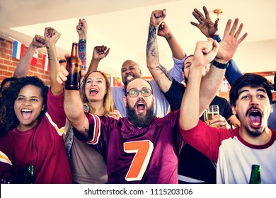 Friends cheering sport at bar together