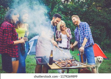 Friends chilling out in nature on camping and preparing food
