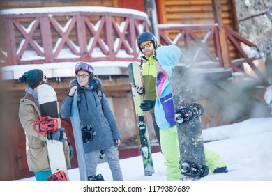 friends coming back from snowboarding