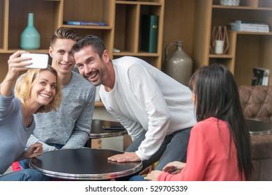 friends doing selfie in cafe