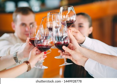 Friends drink wine on the terrace of the restaurant