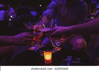 Friends drinking alcohol in pub