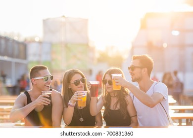 Friends drinking beer at festival