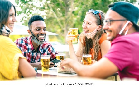 Friends drinking beer with opened face masks - New normal lifestyle concept with people having fun together talking on happy hour at brewery bar - Bright vivid filter with focus on afroamerican guy - Shutterstock ID 1779870584