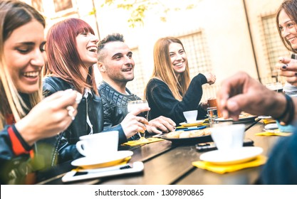Friends drinking cappuccino at coffee restaurant - Millenial people talking and having fun together at fashion bar cafeteria - Friendship concept with happy men and women at cafe - Bright vivid filter