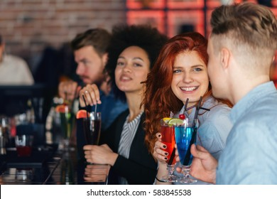 Friends  drinking cocktail in bar