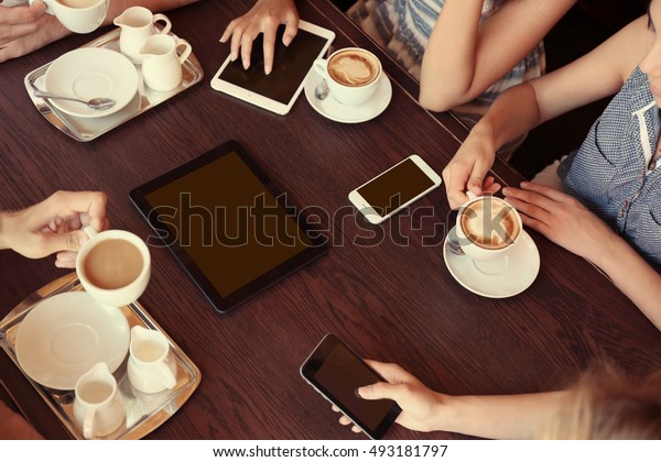 Friends drinking coffee in cafe