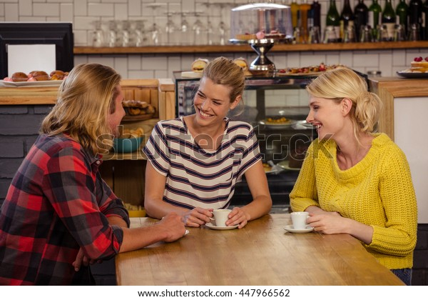 Friends drinking espresso in the cafe