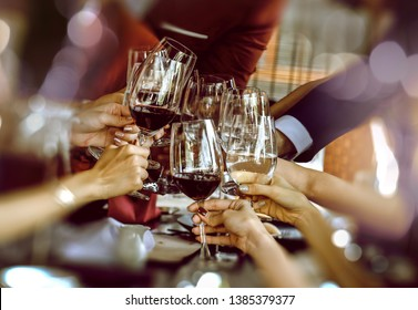 Friends drinking red wine at the party,