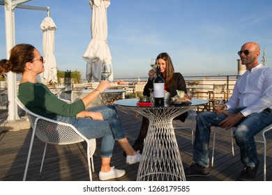 friends drinking wine in a bar