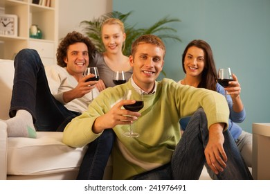 Friends drinking wine at home.