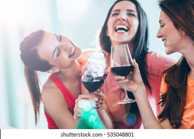 Friends drinking wine in restaurant