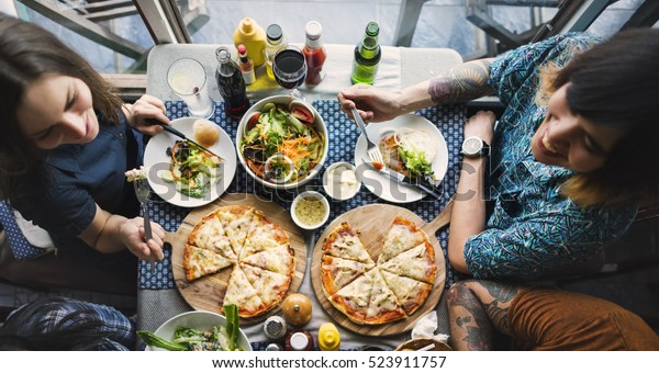 Friends Eating Pizza Party Together Concept