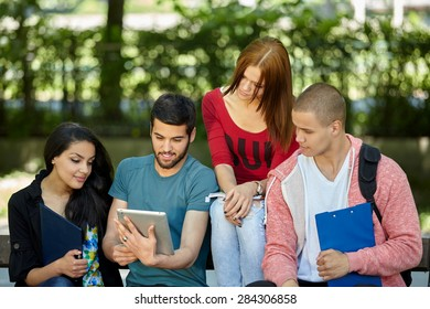 Friends and education, group of university students studying, reviewing homework and preparing test
