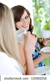 Friends enjoy a hot cup of coffee