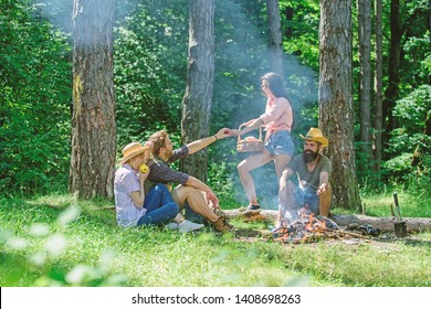 Friends enjoy picnic eat food nature forest background. Plan for perfect day hike picnic. Company friends or family relaxing picnic. Friends relaxing near bonfire. Pleasant hike picnic in forest.