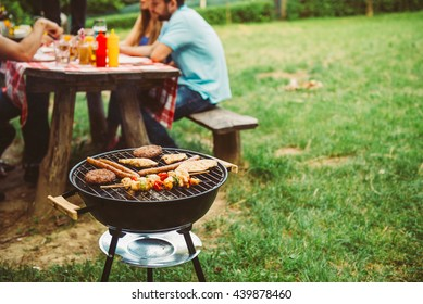 Friends enjoying barbecue time in the nature.