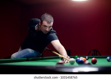 Friends are enjoying in billiard